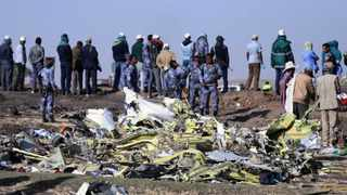 Ethiopian Federal policemen stand at the scene of the Ethiopian Airlines Flight ET 302 plane crash, near the town of Bishoftu. Picture: Reuters/Tiksa Negeri