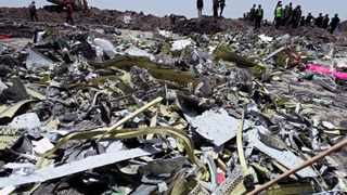 Wreckage is seen at the site of the Ethiopian Airlines Flight ET 302 plane crash, near the town of Bishoftu, Ethiopia. Picture: Reuters/Tiksa Negeri