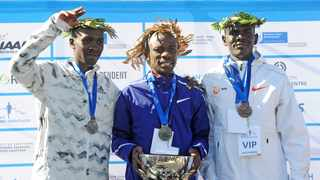 From left: Albert Korir from Kenya (second place), Stephen Mokaka of South Africa (first place) and Philemon Kacherian from Kenya (third place) on the podium after the 2018 Cape Town Marathon. Photo: Ryan Wilkisky/BackpagePix
