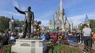 Disney is eliminating smoking areas at its theme and water parks in California and Florida. The company said in a statement on Thursday, March 28 that smoking also won't be allowed at the ESPN Wide World of Sports Complex or Downtown Disney in California starting May 1. (AP Photo/John Raoux)