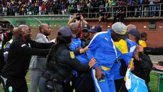 Sundowns coach Pitso Mosimane is led away by police after an incident with AmaZulu security officials at King Zwelithini Stadium last September. Photo: Gerhard Duraan/BackpagePix