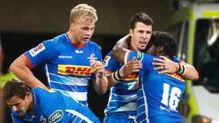 Centre Ruhan Nel celebrates scoring his second try for the Stormers against the Rebels in Melbourne on Friday. Photo: Daniel Pockett/EPA