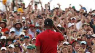 Spectators applaud as Tiger Woods of the U.S. celebrates on the 18th hole to win the 2019 Masters.Photo: REUTERS/Jonathan Ernst