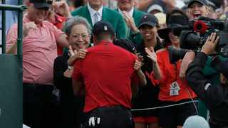 Tiger Woods embraces his son Charlie Axel as his mother Kultida Woods (left), daughter Sam Alexis and girlfriend Erica Herman (right) look on after he won the 2019 Masters. Photo: REUTERS/Mike Segar