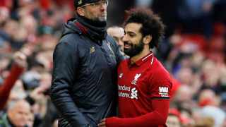 Liverpool's Mohamed Salah is substituted and shakes hands with manager Juergen Klopp. Photo: REUTERS/Phil Noble