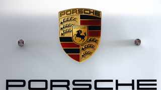 The logo of Porsche AG is seen during a news conference at the company's car production plant in Leipzig, Germany. Photographer: Paul Thomas/Bloomberg