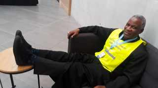 Archbishop Thabo Makgoba shows off his very comfy election takkies. Picture: Norman Cloete