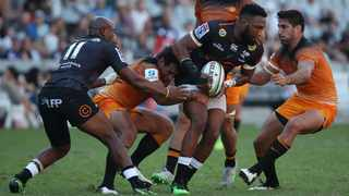 Lukhanyo Am of the Sharks challenged by Jeronimo de la Fuente (right) and Matias Orlando of the Jaguars during their match at Kings Park in Durban in April. Photo: Muzi Ntombela/BackpagePix