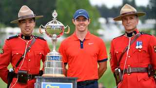 Rory McIlroy poses with the trophy and two members of the Royal Canadian Mounted Police after winning the 2019 RBC Canadian Open. Photo: Eric Bolte-USA TODAY Sports