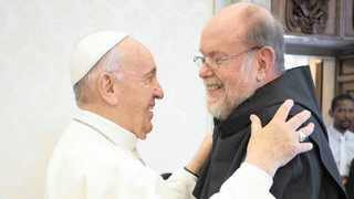 Pope Francis and Father Michael Lapsley shared a hug during a private meeting at the Vatican earlier in June. Picture: Supplied