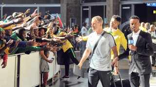 Stuart Baxter is welcomed by fans during Bafana Bafana's arrival from AFCON. Photo: Sydney Mahlangu/BackpagePix