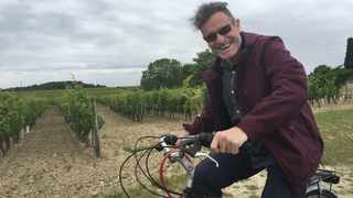 Johnny Clegg riding a borrowed bicycle through the vineyards at Beaumont-en-Véron near Tours in France as his band passed him in a car - July 2016. Picture: Andy Innes