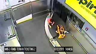 Screenshot: Toddler climbs on to a luggage conveyor belt and is injured. Picture: YouTube.com