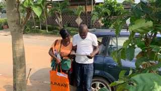 """Viviane Lakpa, a 39-year-old """"co-pilot"""" at Jumia, is responsible for staying on the phone with customers and figuring out where they live in a city with very few addresses. Anzoumana Gbane, 37, is the driver. Picture: Washington Post photo by Danielle Paquette"""