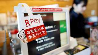 A campaign advertising of Rakuten Pay, a QR code mobile payment system operated by Rakuten, is displayed at a coffee shop in Tokyo, Japan May 30, 2019. Picture taken May 30, 2019.  REUTERS/Issei Kato