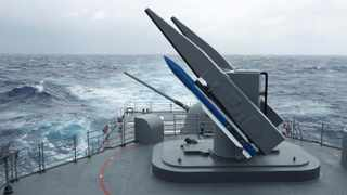 FILE - In this Sept. 26, 2013, file photo, Taiwan's navy practices loading surface-to-air SM-2 missiles from a Kidd class destroyer during the Hai-Biao (Sea Dart) annual exercises off the northeastern coast of Taiwan. Taiwan is responding to China's defense buildup by developing missiles and interceptors of its own that could reduce Beijing's military advantage over the island, defense experts say. (AP Photo/Wally Santana, File)