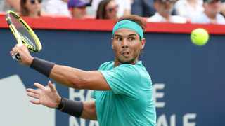 Rafael Nadal hits a shot against Daniil Medvedev during the Rogers Cup tennis tournament at Stade IGA. Photo: Jean-Yves Ahern-USA TODAY Sports