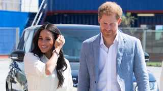 Britain's Prince Harry and his wife Meghan, the Duke and Duchess of Sussex, walk at the Youth Employment Services (YES) Hub as they visit a township in Johannesburg, South Africa, October 2, 2019. Picture: Facundo Arrizabalaga/Pool via REUTERS