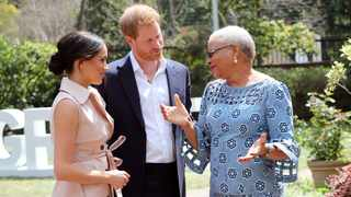 Britain's Prince Harry and his wife Meghan meet Graca Machel, the widow of Nelson Mandela, in Johannesburg. Picture: Reuters/Chris Jackson/Pool