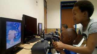 Some of the children who are part of the AeroBudddies programme use the flight simulators