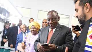 President Cyril Ramaphosa tours the Mara smartphone factory with The Mara Group Chief Executive Ashish Thakkar and the Nkosazana Dlamini-Zuma, the Minister of Cooperative Governance and Traditional Affairs. Photo: Siyabulela Duda (GCIS)