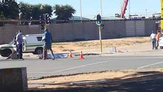 Police stand nect to the body of the woman who was hijacked and killed in Alex. Picture: @Abramjee Twitter