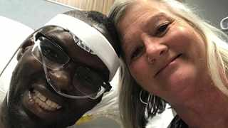 Jonathan Pinkard and Lori Wood smile for a selfie after Pinkard's successful heart transplant in August. Picture: Handout courtesy of Lori Wood