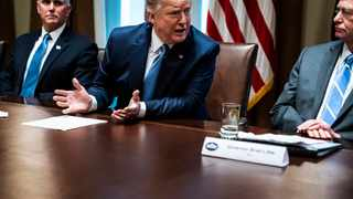 President Donald Trump, flanked by Vice President Mike Pence and Idaho Gov. Brad Little participates in a roundtable discussion at the White House. Picture: Jabin Botsford/Washington Post