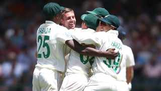 South Africa's Anrich Nortje is congratulated by team-mates after picking up the wicket of England captain Joe Root during day 1 of the second Test at Newlands Cricket Ground in Cape Town on Friday. Photo: Shaun Roy/BackpagePix