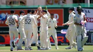 England's players celebrate the wicket of South Africa captain Faf du Plessis on day 2 of the second Test at Newlands Cricket Ground in Cape Town on Saturday. Photo: Shaun Roy/BackpagePix