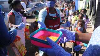 Residents feed children around Europe informal settlement near Gugulethu in Cape Town. Many of the residents have been left without income as they are unable to work during the national lockdown. Picture: Ayanda Ndamane/African News Agency (ANA)