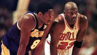 FILE - Los Angeles Lakers guard Kobe Bryant and Chicago Bulls guard Michael Jordan talk during a free-throw attempt during the fourth quarter of a game at the United Center in Chicago in 1997. Photo: Vincent Laforet/AFP