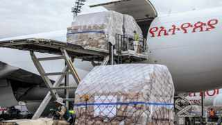 A cargo flight containing over 6 million medical items including face masks, test kits, face shields and protective suits donated by the Jack Ma Foundation and Alibaba Foundation for onward distribution to countries throughout Africa.  Photo by: AP Photo/Mulugeta Ayene