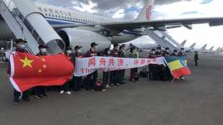 Members of a Chinese medical team pose for a photo upon their arrival at the airport in Addis Ababa, Ethiopia. Photo by: Xinhua/Wang Shoubao