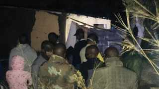 Police and community members a homestead at eMsahweni on the KZN south coast where seven men were killed on Wednesday night. Picture: Supplied.