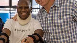 Lifa Hlongwa, who was left paralysed in 2017 after a tackle in a club rugby game went wrong, pictured with former Springboks captain John Smit. Photo: supplied