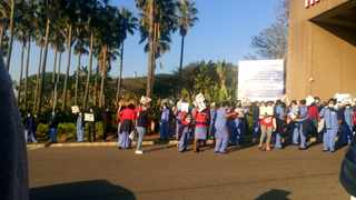 INKOSI Albert Luthuli Central Hospital (IALCH) healthcare workers downed tools this morning in protest of Covid-19 protocols at the hospital. Staff held placards at the entrance to the hospital, delaying the movement of traffic into the hospital. Picture: Thobeka Ngema.