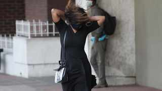 A gust of wind blows a woman's hair while she is walking along the Durban Esplanade  Picture: Doctor Ngcobo/African News Agency(ANA)