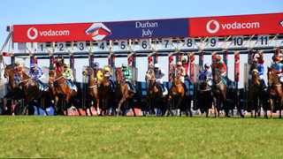 Horses jumping from the gates on Vodacom Durban July Day 2019 at Hollywoodbets Greyville. Photo Credit: John Lewis