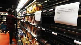A shopper stands near empty shelves in a store in Canal Walk after there was a product recall for ready to eat meat products including viennas and polony due to the listeriosis outbreak.  Picture: Cindy Waxa/ African News Agency (ANA)