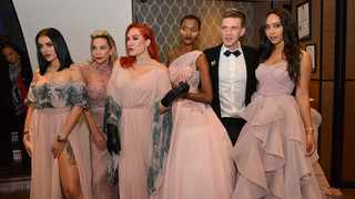 PASSION FASHION: Gert-Johan Coetzee poses  with celebrity models at the Night of the Stars even last year