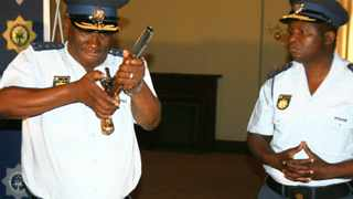 National police commissioner Bheki Cele demonstrates how to load and fire an antique flintlock pistol during a media conference on an amendment to the firearms licence application process. Photo: Graeme Hosken