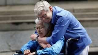 Phyllis Siegel, 77 (left), and Connie Kopelov, 85, both of New York, embrace after becoming the first same-sex couple to get married at the Manhattan City Clerk's office on Sunday.