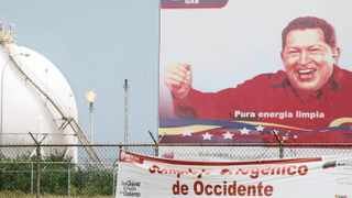 A sign shows Venezuelan President Hugo Chavez at the gas processing plant in the  Jose in Anzoategui state. The complex, that makes refined crude from the heavy oil of the Orinoco Belt, is a joint venture between Venezuelan state owned PDVSA and foreign companies. Photo: Bloomberg.