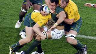 Australia Wallabies' James O'Connor (left) and Rocky Elsom tackle Pierre Spies during their Rugby World Cup quarter-final.  Picture: REUTERS/Anthony Phelps