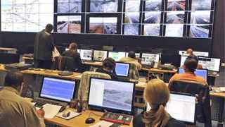 Officers monitor traffic from the Traffic Management Centre in Goodwood. New cameras will be able to read number plates and alert police to a range of road crimes. Photo: Murray Williams