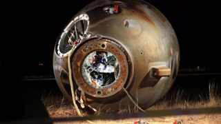 File photo of a technician inspecting the re-entry capsule of Shenzhou 8 spacecraft. Picture: AP Photo/Xinhua, Li Gang