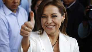 Josefina Vazquez Mota, presidential hopeful from Mexico's ruling conservative National Action Party shows her ink-stained finger during the primary election to choose the PAN presidential candidate in Mexico city.