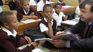 Cape Town-120216-Donald Grant briefly visited two school which would receive Litnum awards. At Cavalleria Primary in Scottsdene Donald Grant chats to Grade 4 learners Tameca Jacobs and Jade Mandindi. Reporters Michelle Jones, Sibongakonke Mama. Picture Jeffrey Abrahams
