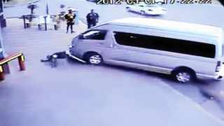 A screen grab taken from a video show how a taxi driver bumps into a pedestrian and assaults the man while he is lying on the pavement. Photo: Youtube